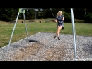 Blonde sexy Girl on a swing in Minidress and Highheels outdoor