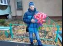 Победитель мини-конкурса с букетом ромашек