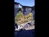 Волга пробила бетонный забор
