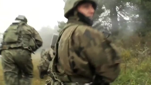 Polish Army In Action During Intense Combat Firefight Assault Training Live Fire NATO Exercise