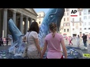 Greenpeace protest plastic pollution with lifesize whales outside Pantheon