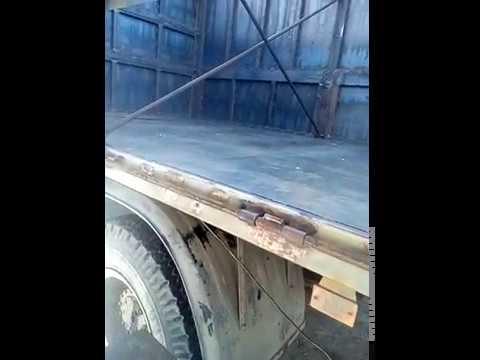 Конструкция закрытий бортов кузова и прицепа зерновоза .
