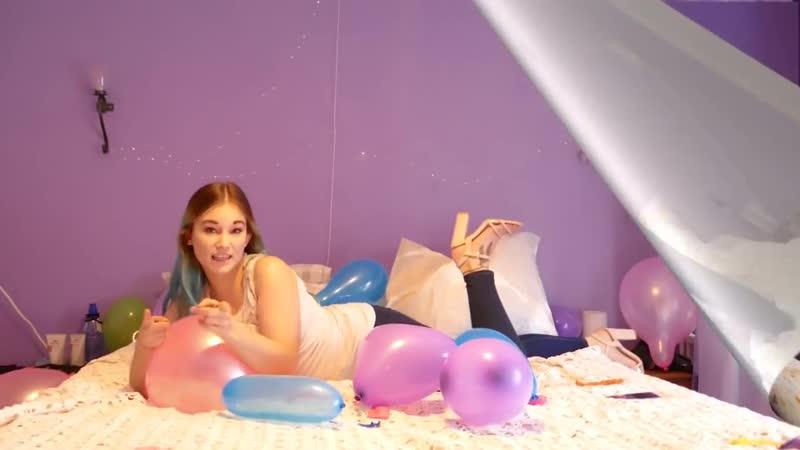 KarinB Girl Popping Balloons
