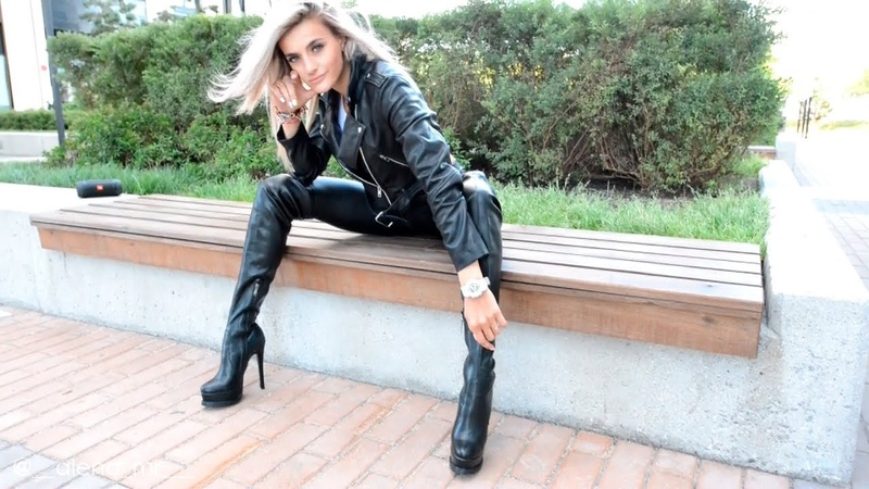 Blonde in high leather boots. Thigh Length Boots in leather leggings