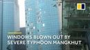 Windows blown out as Typhoon Mangkhut hammers Hong Kong's Kowloon