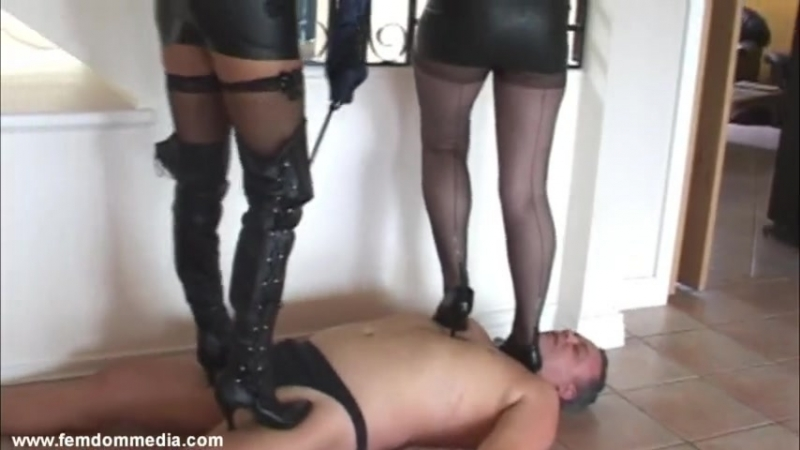 Two girls hard trampling black boots and heels