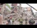 Снежное 15 июля 2014 Убитых из завалов грузят в ковши экскаваторов