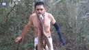Man hangs six SNAKES from his MOUTH while standing on SPIKES!