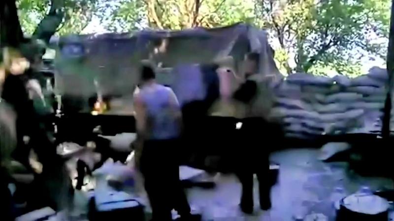 Славянск. 11 июня, 2014. г. Карачун, военные ВСУ после обстрела.