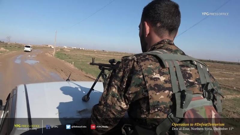 Боевики SDF заезжают в город Хаджин