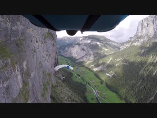 The Flyby- Wingsuit Buzzes BASE Jumper Under Canopy