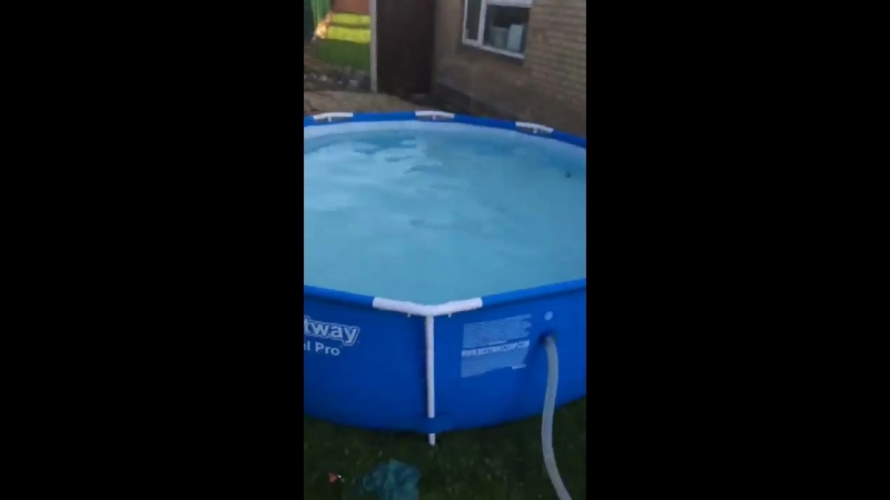 Lad sleds off roof in to pool