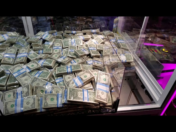 Trying to win cash from the claw machine on a cruise ship (real money)
