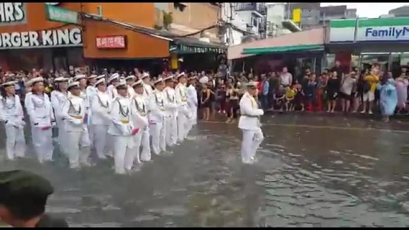 Марш моряков РФ в Корее после сильного дождя