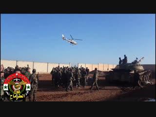 Бригадный генерал Сухейль Аль-Хасан приветствует своих солдат полка Ат-Тармах