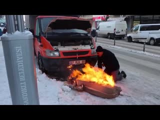 Extreme engine cold start with fire
