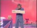 Rapid-fire cigar box juggling (sort of looks like he has 3 hands