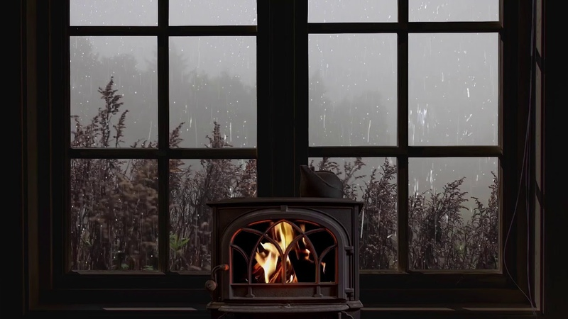 Rain on window crackling fire and misty atmosphere for sleep study relax