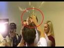 Protestor cracks an egg over Senator Fraser Anning's head