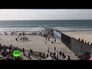 Dozens of migrants climb border fence near Tijuana, Mexico - YouTube