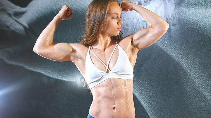 19 years old muscle girl Cassiane Buzan flexing her biceps
