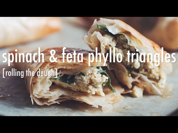 Spinach feta phyllo triangles (rolling the dough)
