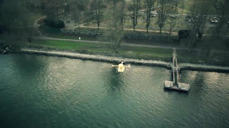 Microdrone md4-1000 DHL parcel copter transports medicine across river