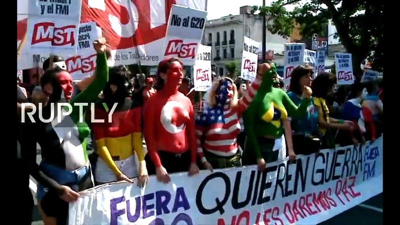 G20 МВФ и капиталисты вон Революционные голые женские груди против Трампа Путина и кронпринца в Буэнос Айресе а Марше единства 01 12 2018