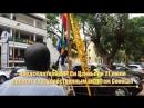 На улицах Дакара столицы Сенегала вывешивают государственные флаги двух стран