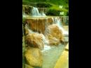Большой и облагороженный водопад в городском парке Сидзуока