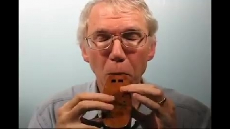 The wooden Double Ocarina built and played by Charlie Hind