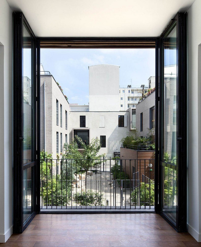 Social Housing and Artist Studios / Moussafir Architectes