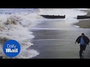 Prankster attempts to race the tide before being wiped out
