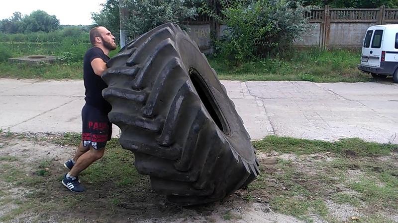 293 кг на 10 раз кантовка покрышки