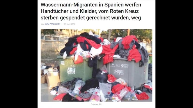 Aquarius-Migranten in Spanien werfen Handtücher und Kleider, die vom Roten Kreuz gespendet werden