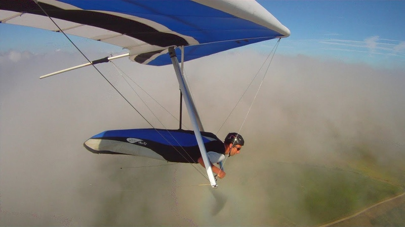 Hang gliding in orographic cloud at Ringstead Bay, Dorset 25 July 2013
