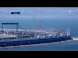 Комментарий Алексея Журавлева на фоне видеокадров исторического события - официального начала движения по Крымскому мосту