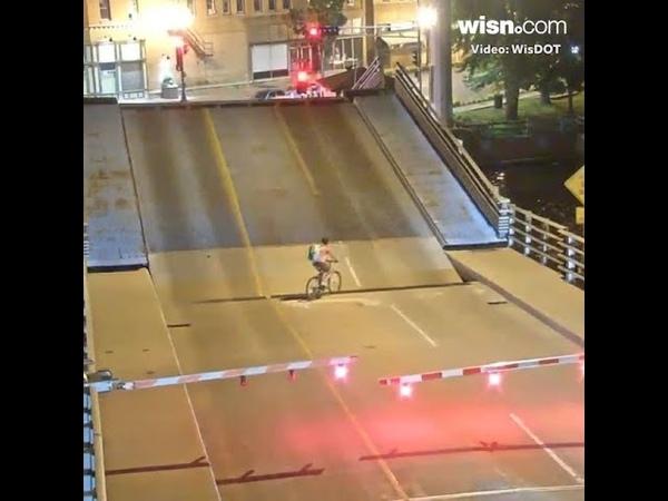 Video shows bicyclist falling into Wisconsin draw bridge
