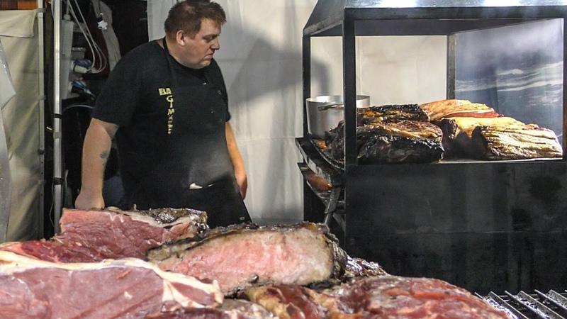 Irish Street Food. Huge Roast Beef Blocks on Grill and Black Angus Hamburgers