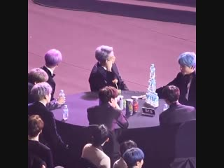 Not at taehyung protecting his tower of water bottles while jinmin were tryin to knock it