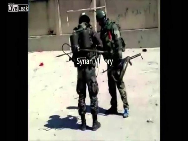 SAA soldier burns FSA flag with flamethrower - on a cleansed building