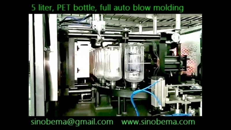 Full automatic bottle blow molding machine for 5 liter PET water bottles.