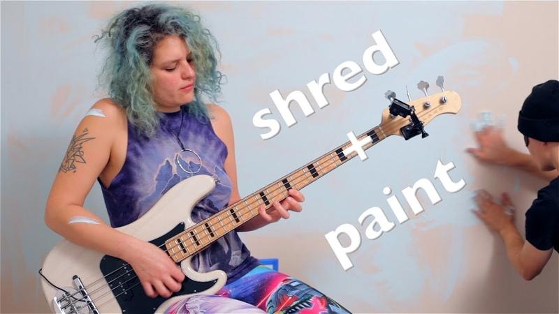 Shredding bass Adrian Belew Power Trio's e while a boy paints.