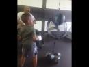 Тренер учит юного боксёра наносить удары