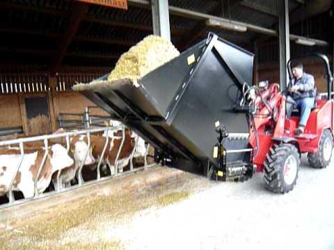 Schaeffer 2027 pivot steer yard loader with silage dispenser