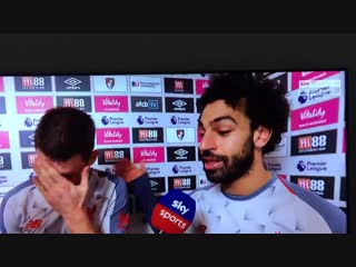 Mo Salah handing over his MOTM award to Milner to commemorate his 500th PL appearance. Cla