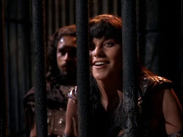 Цезар виводить Ксену на гладіаторську арену (Ксена: принцеса-воїн)