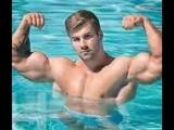 IFBB Pro Jake Burton jed north athlete flexing and workout