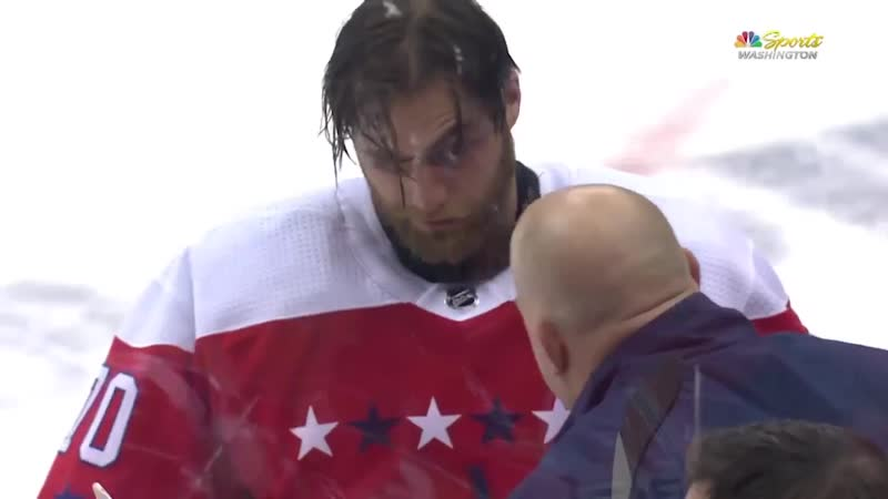 Braden Holtby takes a stick to the face THROUGH his mask and did not return to the game