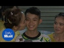 Heartwarming moment rescued Thai cave boy returns home to family
